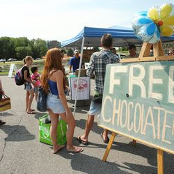 Attendees get s sample during the Sugar House Farmers Market in Sugarhouse Park in Salt Lake City Friday, July 5, 2013.