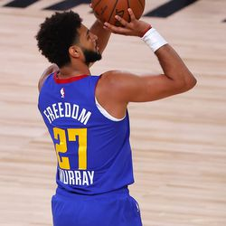 Denver Nuggets' Jamal Murray shoots a three-point basket during the second quarter of an NBA basketball game against the Utah Jazz, Saturday, Aug. 8, 2020, in Lake Buena Vista, Fla.