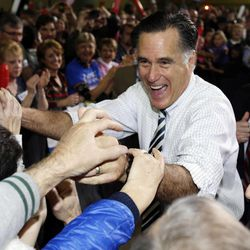 Republican presidential candidate and former Massachusetts Gov. Mitt Romney greets supporters as he campaigns at the3Iowa Events Center, in Des Moines, Sunday, Nov. 4, 2012.