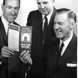 President James E. Faust, Francis M. Gibbons and John Preston Creer check over a state lawyer convention program in 1963.