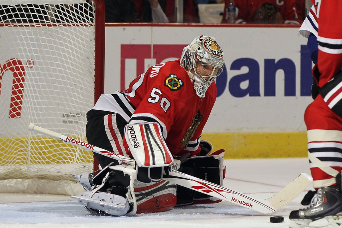 CHICAGO, IL - DECEMBER 21: Corey Crawford #50 of the Chicago Blackhawks makes a save against the Montreal Canadiens at the United Center on December 21, 2011 in Chicago, Illinois. (Photo by Jonathan Daniel/Getty Images)