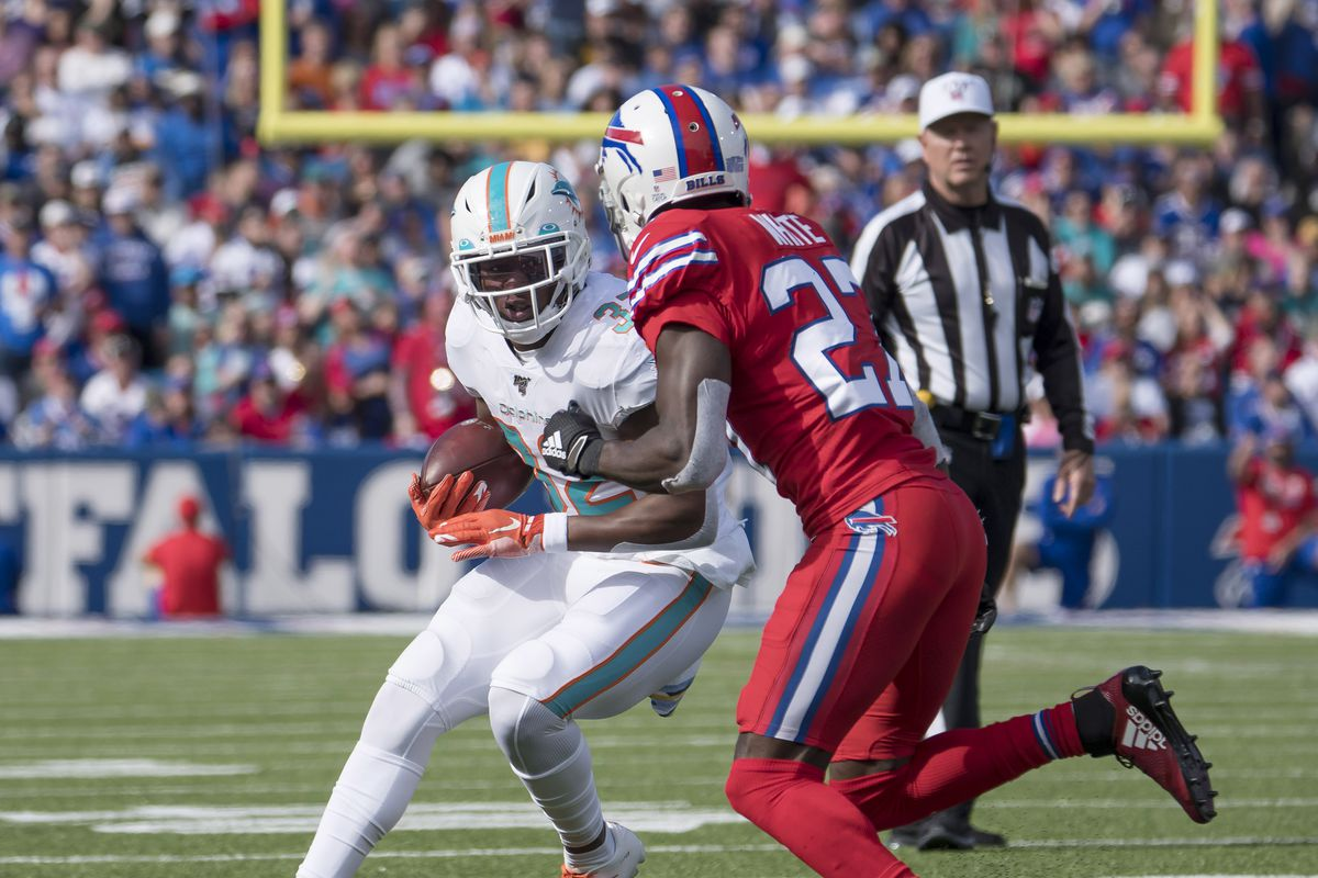 Miami Dolphins running back Kenyan Drake carries the ball as Buffalo Bills cornerback Tre'Davious White defends during the second quarter at New Era Field.
