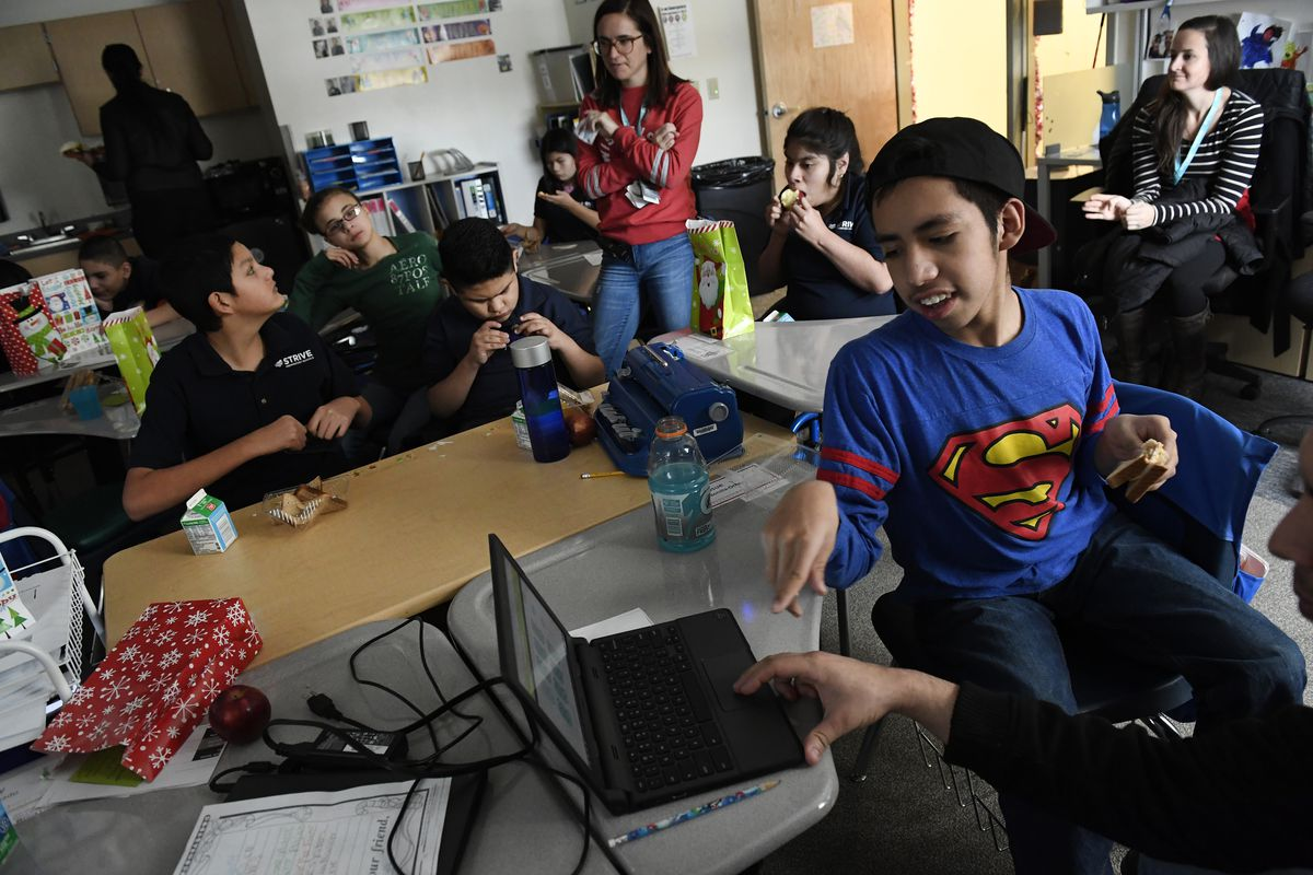 Josue Bonilla, 13, in Superman shirt, in STRIVE Prep Federal's Wisconsin classroom (Photo by Helen H. Richardson/The Denver Post for Chalkbeat).