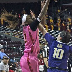 Desiree Bradley takes a hand to the face, but knocks down the 3-pointer.