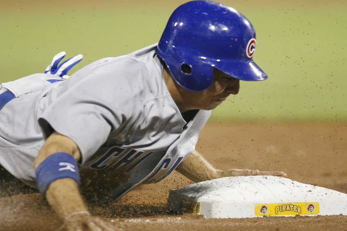 Pittsburgh, PA, USA; Chicago Cubs center fielder Tony Campana steals third base against the Pittsburgh Pirates at PNC Park. The Chicago Cubs won 4-3. Credit: Charles LeClaire-US PRESSWIRE