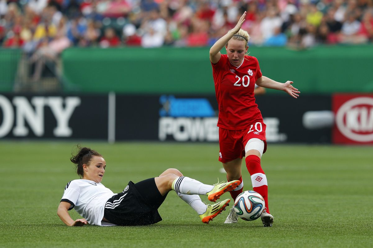 LSU's Emma Fletcher fights for the ball while playing for Canada at the 2014 FIFA U-20 Women's World Cup