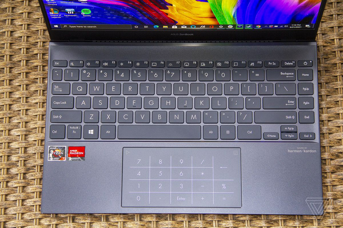 The Asus Zenbook 13 OLED keyboard seen from above. The screen displays an LED numpad.