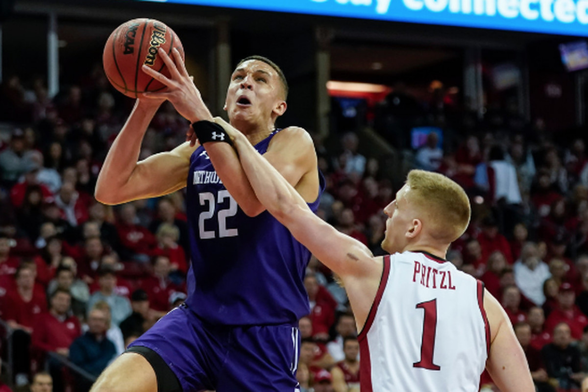 Northwestern's Pete Nance takes the ball to the basket while being fouled by Wisconsin's Brevin Pritzl on Wednesday in Madison, Wis.