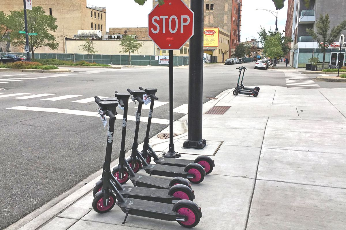 Lyft scooters parked at a West Loop corner.
