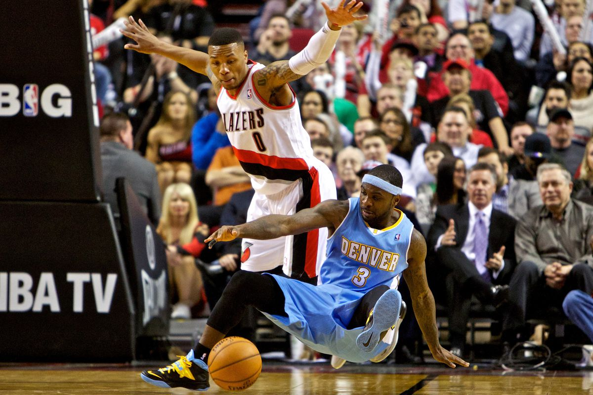 Ty Lawson stumbles to the floor against the Trail Blazers