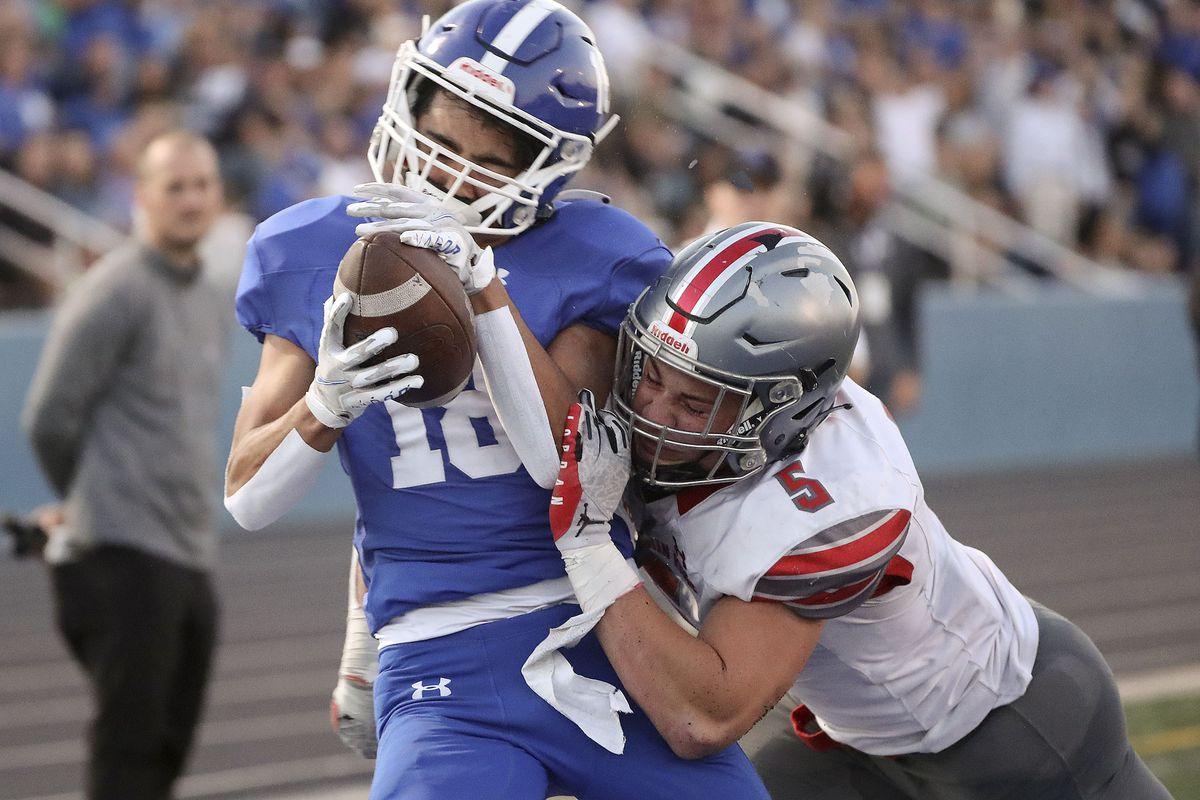 Mountain Ridge's Cade Uluave tackles Bingham's Maddax Peck during a high school football game at Bingham High School in South Jordan on Friday, Sept. 24, 2021. Bingham won 45-14.
