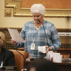 Rep. Susan Duckworth, D-Magna, makes light of the toilet paper plight during the last night of the 2020 legislative sessionat the Capitol in Salt Lake City on Thursday, March 12, 2020.