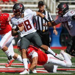 Washington State quarterback Jarrett Guarantano (18) gets pressured by Utah defense during an NCAA college football game at Rice-Eccles Stadium on Saturday, Sept. 25, 2021 in Salt Lake City.