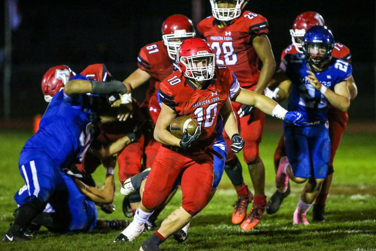American Fork's Jaxon Gregory (10) runs the ball during the game against Pleasant Grove at American Fork High School  in American Fork on Friday, Oct. 5, 2018.