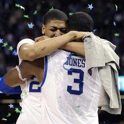 Kentucky forward Anthony Davis hugs forward Terrence Jones (3)after the NCAA Final Four tournament college basketball championship game Monday, April 2, 2012, in New Orleans. Kentucky beat Kansas 67-59.