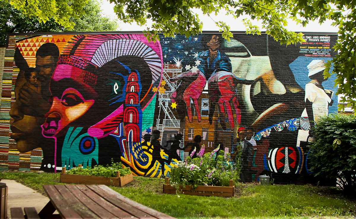 """In 1993, Bernard Williams restored this mural at 39th Street and Michigan Avenue by Mitchell Caton and Calvin Jones titled """"Another Time's Voice Remembers My Passion's Humanity."""""""