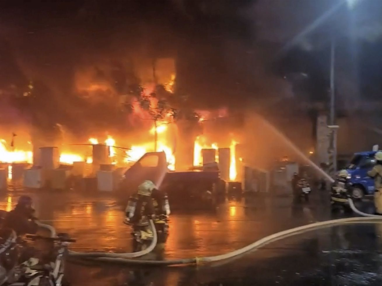 In this image taken from video by Taiwan's EBC, firefighters battle a blaze at a building in Kaohsiung, in southern Taiwan on Thursday, Oct. 14, 2021. The fire engulfed a 13-story building overnight in southern Taiwan, the island's semi-official Central News Agency reported Thursday.