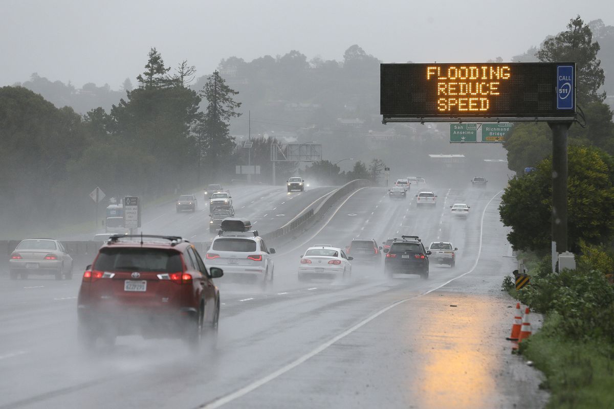 A sign warns motorists of flooding on northbound Highway 101, Monday, Feb. 20, 2017, in Corte Madera, Calif. Heavy downpours are swelling creeks and rivers and bringing threats of flooding in California's already soggy northern and central regions. The Na