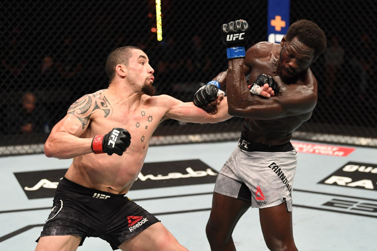 Robert Whittaker and Jared Cannonier at UFC 254