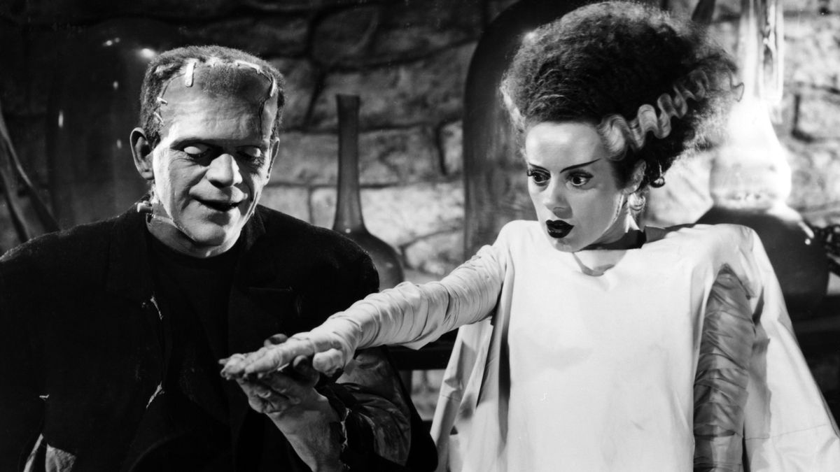 In a black-and-white still from The Bride of Frankenstein, Boris Karloff greets Elsa Lanchester as his newly created mate.