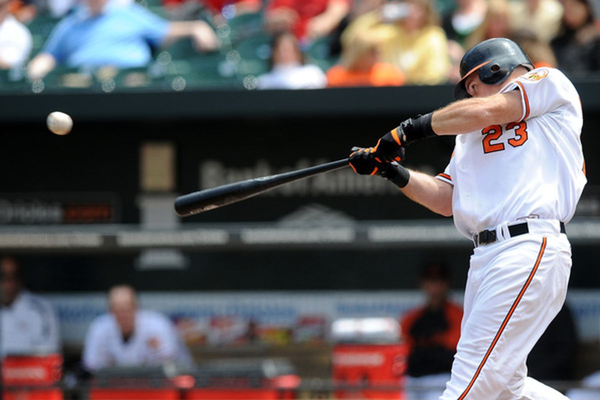 BALTIMORE - MAY 13:  Ty Wigginton #23 of the Baltimore Orioles hits a single in the fourth inning against the Seattle Mariners at Camden Yards on May 13, 2010 in Baltimore, Maryland.  (Photo by Greg Fiume/Getty Images)