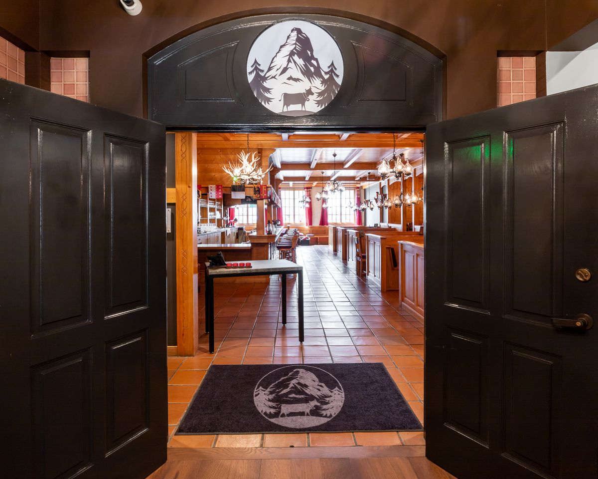 The entrance to the restaurant at the end of the building's hallway