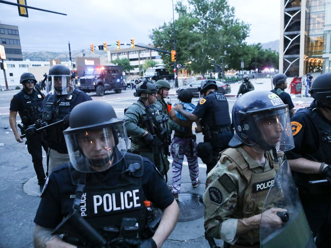 A protester who refused to move when facing off with police while demonstrating against police brutality is taken in by officials in Salt Lake City on Saturday, May 30, 2020. Daylong protests moved across the city Saturday after a peaceful demonstration to decry the death of George Floyd in police custody in Minneapolis turned violent.