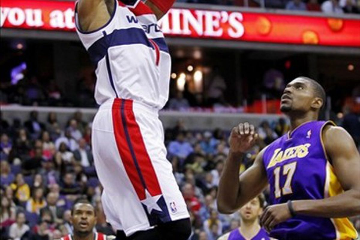 March 7, 2012; Washington, DC, USA; Washington Wizards shooting guard Nick Young (1) dunks the ball over Los Angeles Lakers center Andrew Bynum (17) in the first half at Verizon Center. Mandatory Credit: Geoff Burke-US PRESSWIRE
