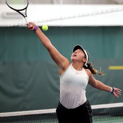 Highland's Dylan Lolofie tries a reverse hit as she battles Sage Bergeson of Woods Cross for the 5A tennis state championship at Salt Lake Tennis & Health Club on Saturday, Oct. 9, 2021.