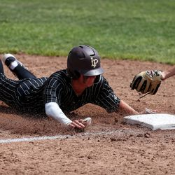 Lone Peak's Ryder Christensen slides safely into third on a steal past the tag from Riverton's Sam Beck in a high school baseball game in Highland on Tuesday, June 2, 2020.