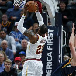 Utah Jazz forward Royce O'Neale (23) goes to the hoop as Utah Jazz forward Joe Ingles (2) falls during the game at Vivint Smart Home Arena in Salt Lake City on Saturday, Dec. 30, 2017.