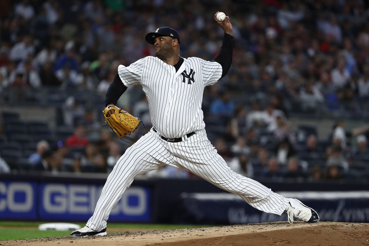 New York Yankees pitcher CC Sabathia throws a baseball from the pitcher's mound.