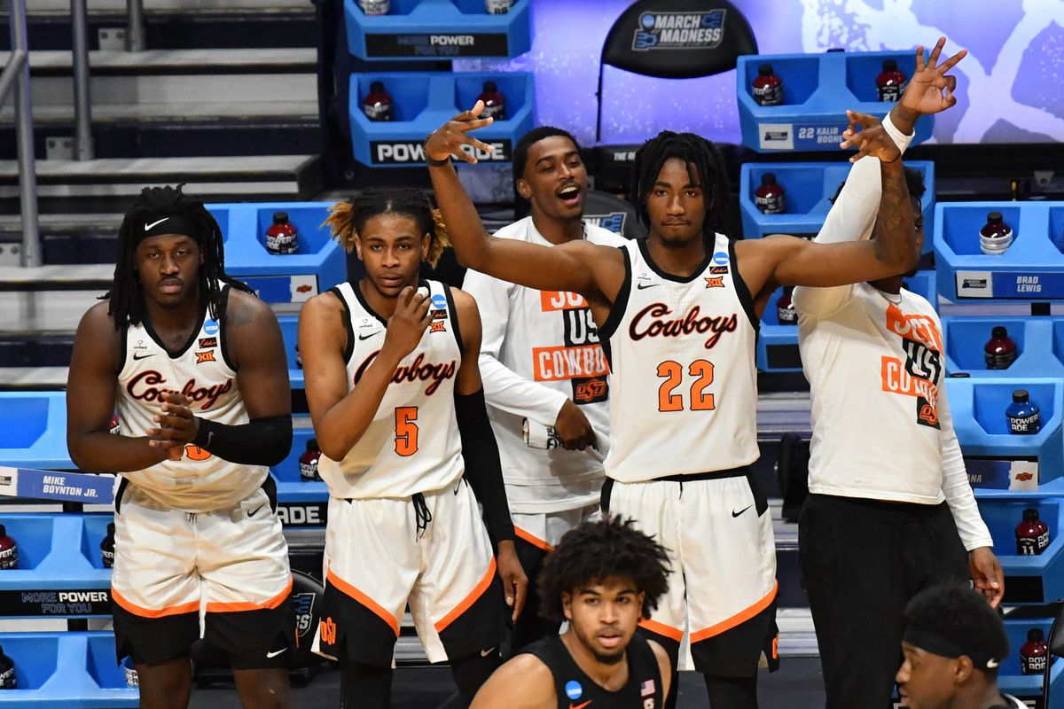 The Oklahoma State Cowboys bench reacts during the second half in the second round of the 2021 NCAA Tournament against the Oregon State Beavers at Hinkle Fieldhouse.