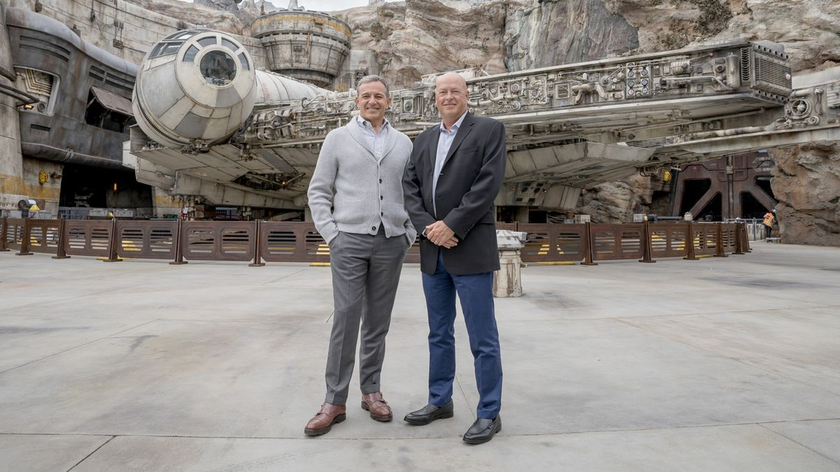Bob Iger and Bob Chapek standing in front of the Millennium Falcon at Star Wars: Galaxy's Edge