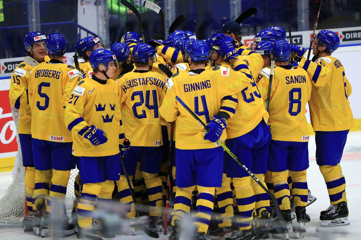 Sweden's players celebrate victory in the 2020 IIHF World Junior Ice Hockey Championship bronze medal match against Finland at Ostravar Arena; Sweden won 3-2.