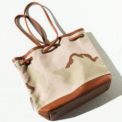 "<b>Bags in Progress</b> Drawstring Bag, <a href=""https://frenchgarmentcleaners.com/catalog/womens/products/s13-drawstring-bag-camo"">$240</a> at French Garment Cleaners"