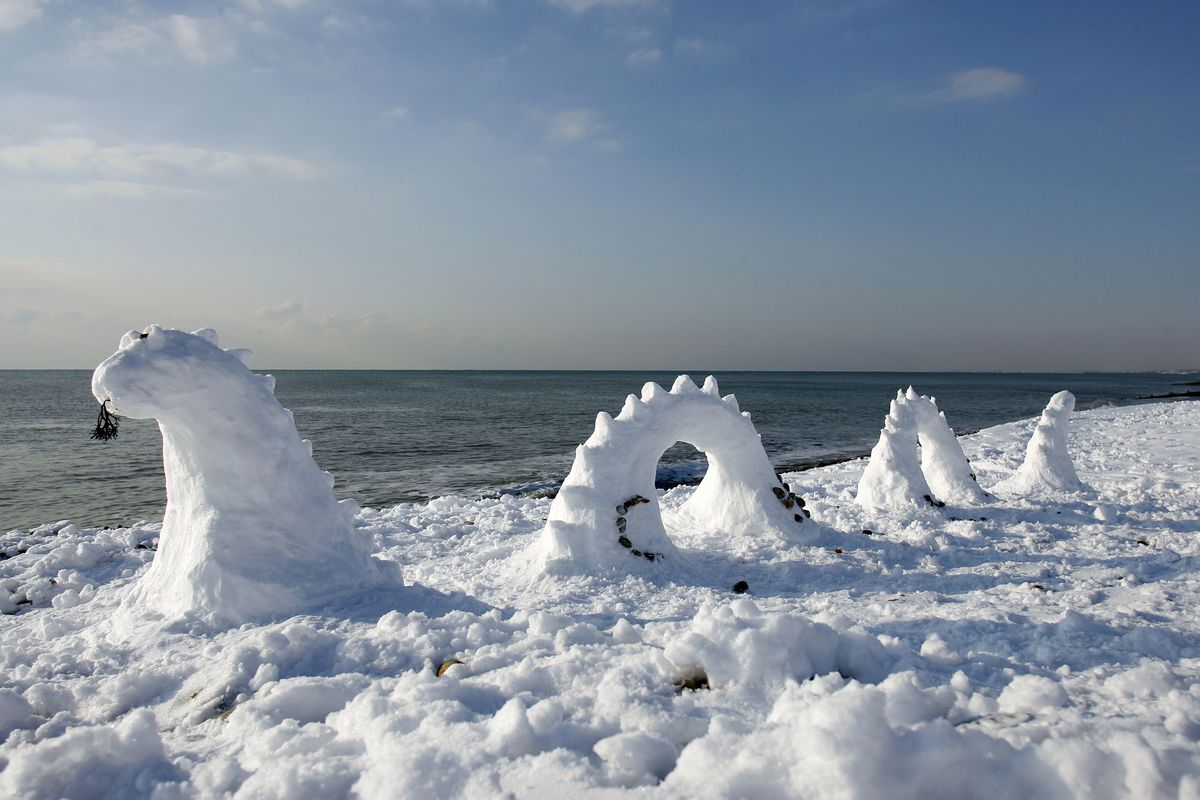 A snowy model of the Loch Ness Monster is one of the ways the monster is debunked. (Glyn Kirk/ Stringer/Getty Images)