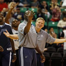 Coaches for the white team ask why their team took a two-point shot at the end of the game when they were down by three points after the Jazz's scrimmage in Salt Lake City, Saturday, Oct. 5, 2013.
