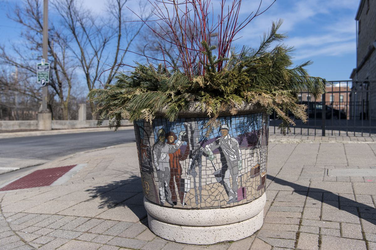 Planters like this one near the Stephen Street Bridge in Lemont feature mosaics.