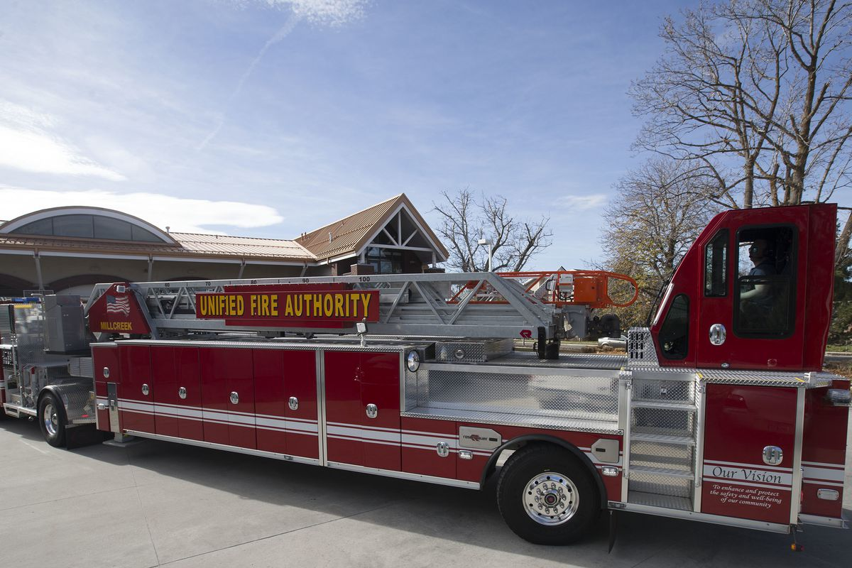 FILE - Unified Fire Authority fire fighters drive a new Rosenbauer Tractor Drawn Aerial Fire (TDA) Truck at Unified Fire Station 106 in Millcreek on Thursday, Nov. 9, 2017. The group Alliance for a Better Utah on Tuesday called on Salt Lake County Council