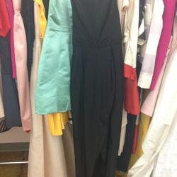 Floor-length black gown with slit, $400