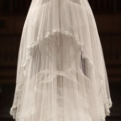 LONDON - JULY 20:   The Duchess of Cambridge's wedding dress, designed by Sarah Burton for Alexander McQueen, is photographed before it goes on display at Buckingham Palace during the annual summer opening on July 20, 2011 in London, England. The Duchess
