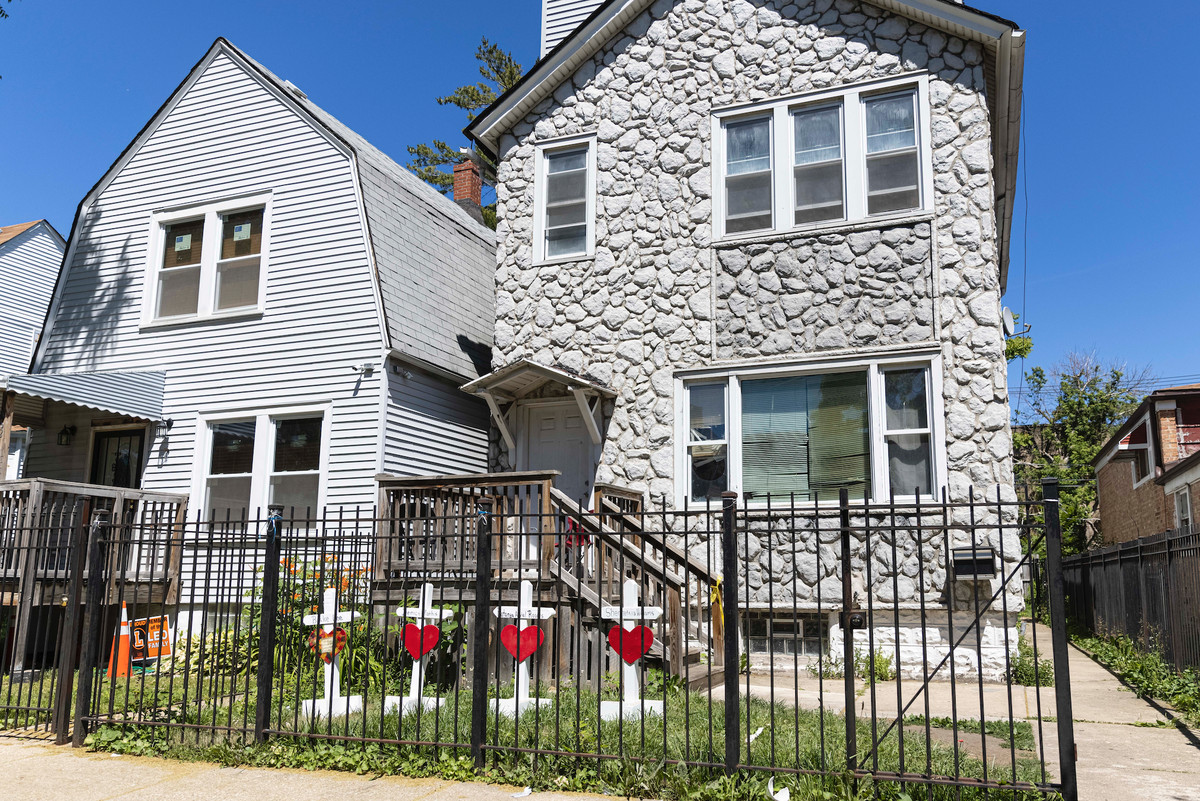 A memorial was set up Wednesday, June 16, 2021, in the front yard of a home where eight people were shot, four fatally, in the 6200 block of South Morgan Street.