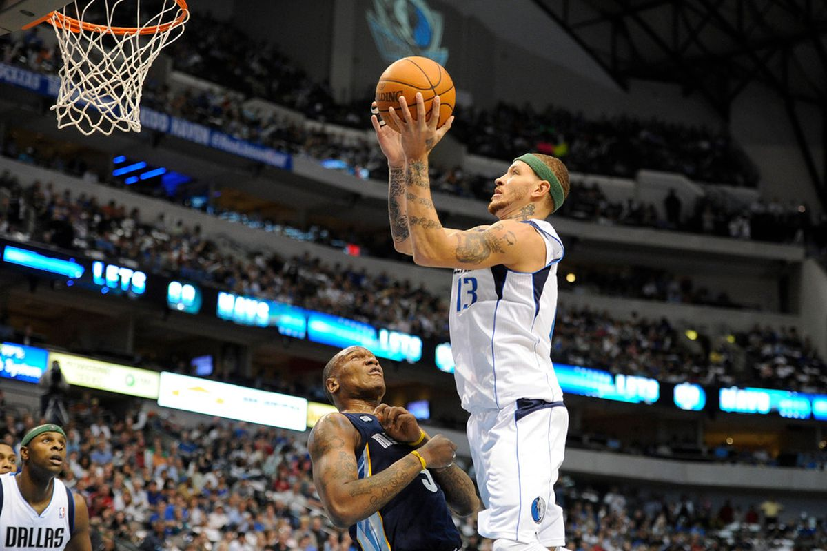 Apr 4, 2012; Dallas, TX, USA; Dallas Mavericks shooting guard Delonte West (13) shoots over Memphis Grizzlies center Marreese Speights (5) during the first quarter at the American Airlines Center. Mandatory Credit: Jerome Miron-US PRESSWIRE