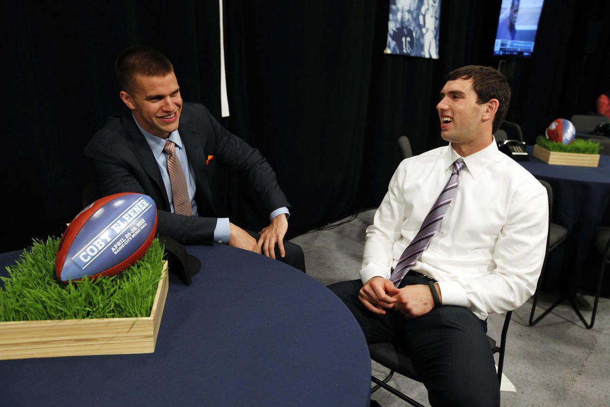 Stanford quarterback Andrew Luck, right, waits with Stanford's Coby Fleener before the first round of the NFL football draft at Radio City Music Hall, Thursday, April 26, 2012, in New York.