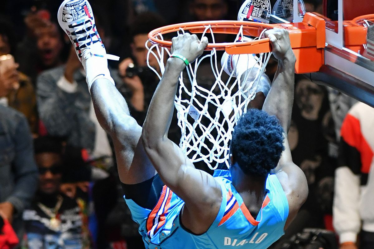 Hamidou Diallo of the Oklahoma City Thunder dunks the ball over Shaquille O'Neal during the 2019 AT&T Slam Dunk Contest as part of the State Farm All-Star Saturday Night at Spectrum Arena in Charlotte, NC, United States on February 16, 2019.