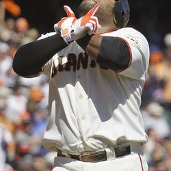 San Francisco Giants' Pablo Sandoval gestures while crossing home plate after hitting a home run off Colorado Rockies starting pitcher Jorge De La Rosa in the first inning of a baseball game in San Francisco, Thursday, Sept. 20, 2012.