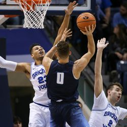 San Diego Toreros forward Isaiah Pineiro (0) shoots against Brigham Young Cougars forward Yoeli Childs (23) and guard Zac Seljaas (2) at the Marriott Center in Provo on Saturday, Jan. 20, 2018.