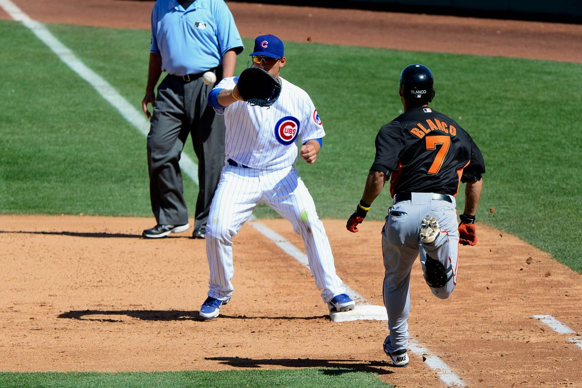 Chicago Cubs first baseman Anthony Rizzo catches the ball to force out San Francisco Giants center fielder Gregor Blanco at first base during the fifth inning at HoHoKam Park. Credit: Matt Kartozian-US PRESSWIRE