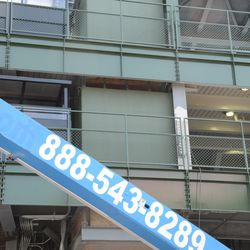3:11 p.m. The left field incomplete elevator shaft visible, under the video board/left-field porch -